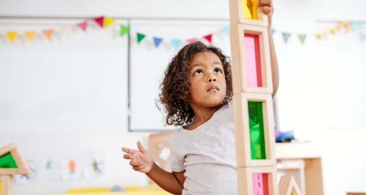 a young child playing with blocks