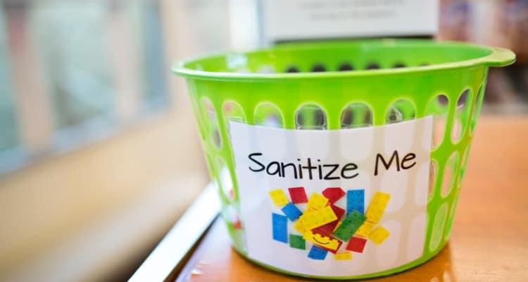 bucket with sanitize me written on it
