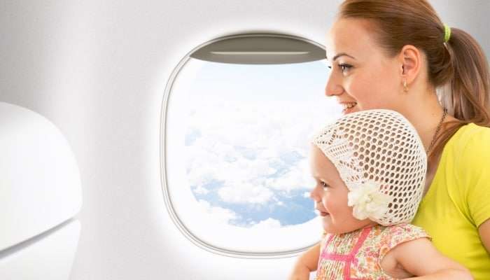 woman traveling with kid on airplane