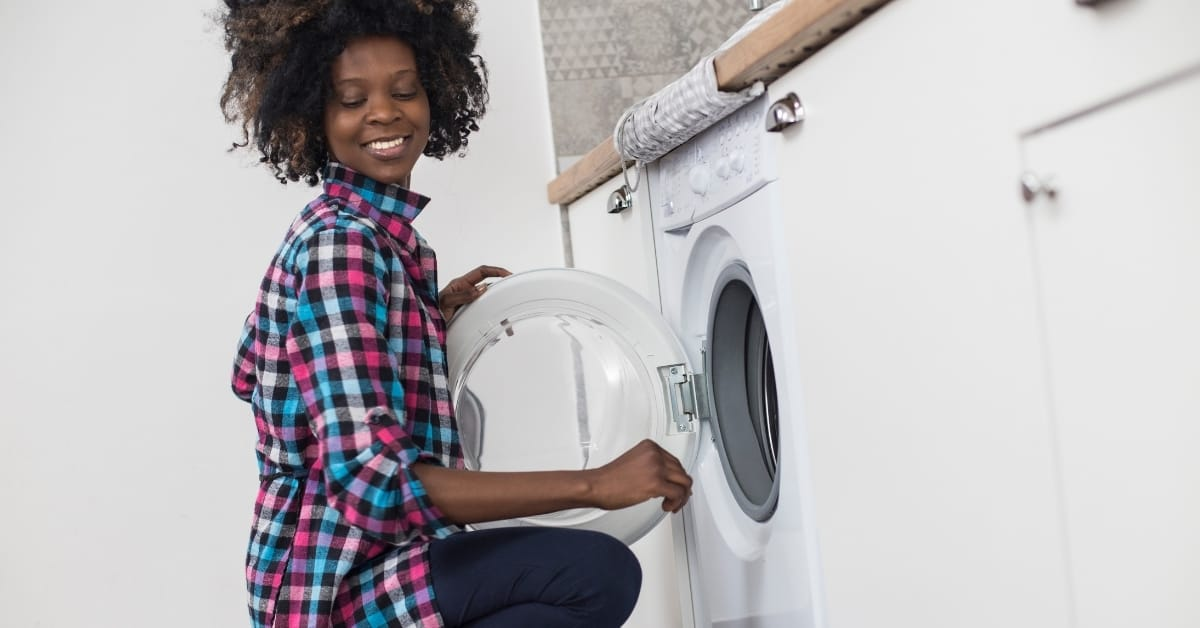 childcare provider doing laundry
