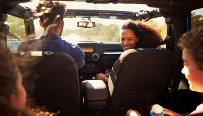 family in car for roadtrip