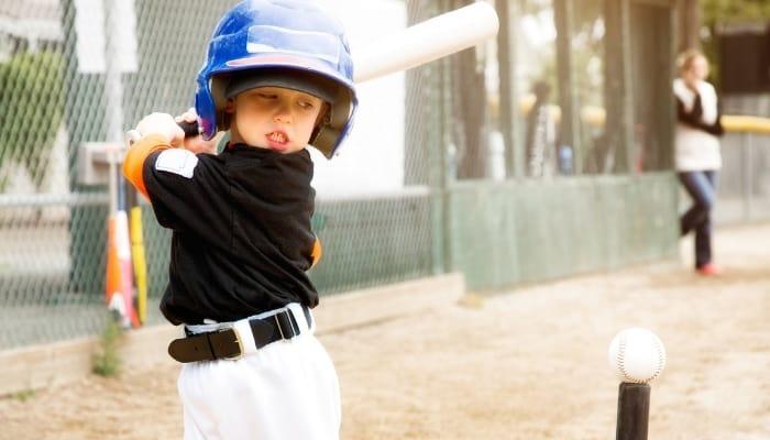 child swinging a bat