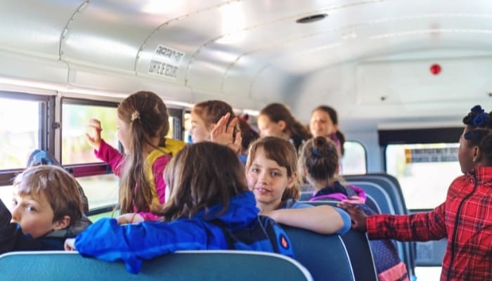 young children on a school bus