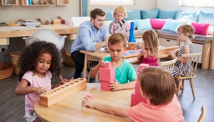 Montessori teacher and kids