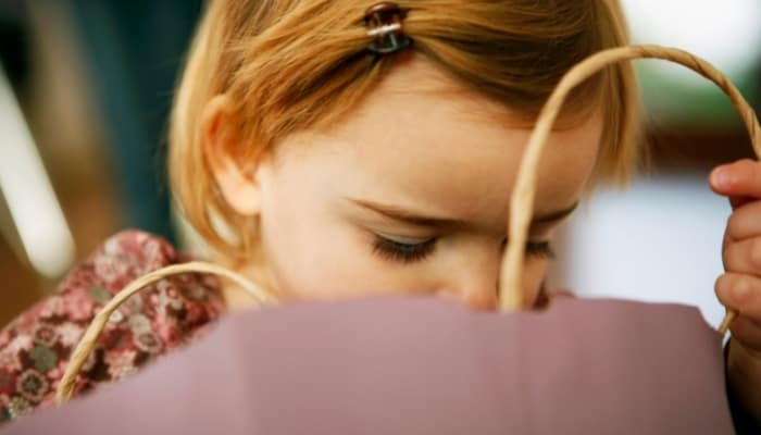 a child looking in a bag