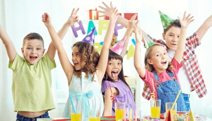 kids at birthday party celebrating