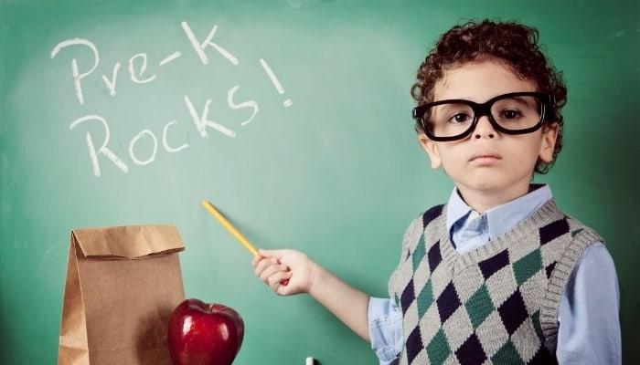 boy in front of chalk board