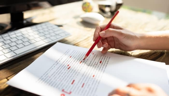 a person proofreading written work