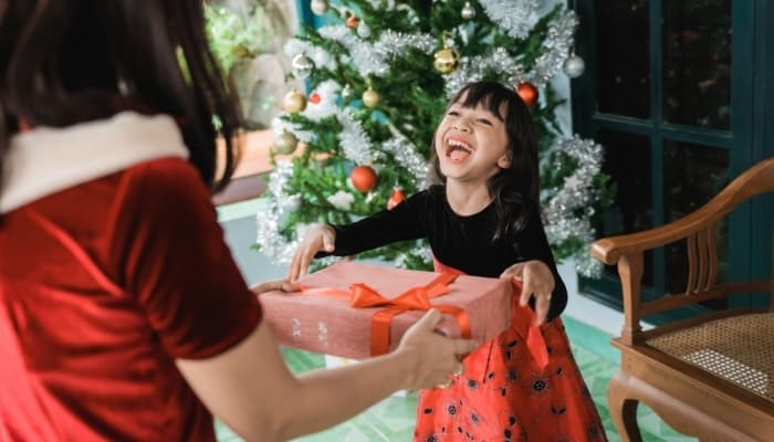 a kid happy to receive a gift