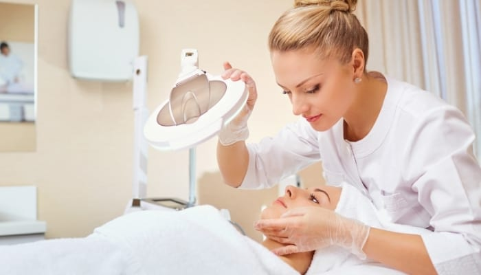 a cosmetologist with a patient
