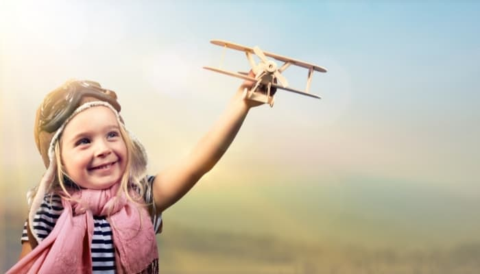 a kid holding a toy airplane