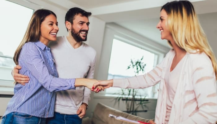 a realtor talking to a married couple