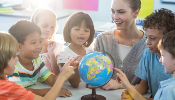 teacher and students learning geography