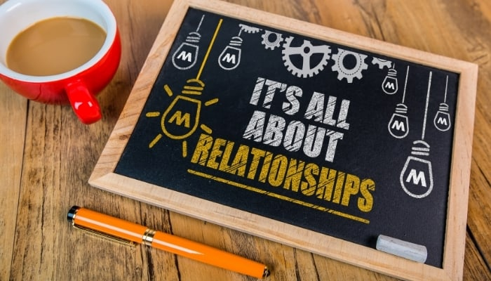 sign that says it's about relationships