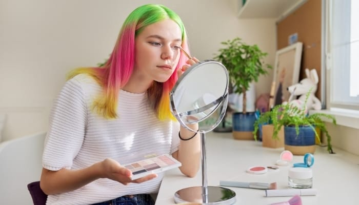 teenager with pink green yellow hair dyed