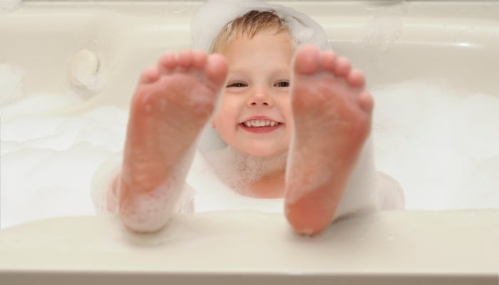 child in bathtub
